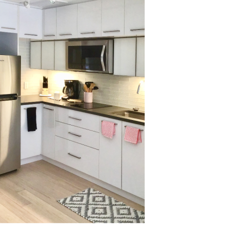 Micro-apartment kitchen with white cabinets