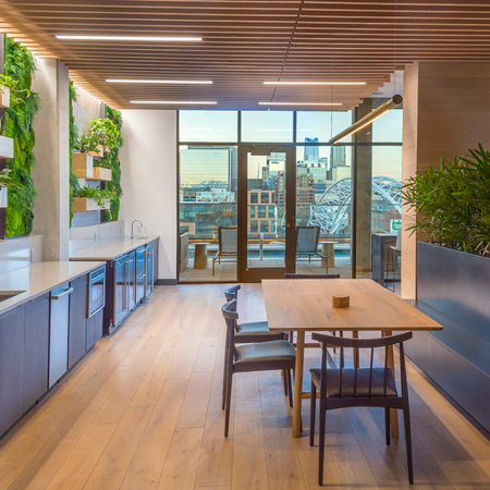 Clubroom with moss wall dining areas and gorgeous views of Denver