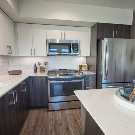 Kitchen with island and bi-color cabinets