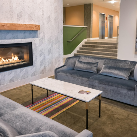 Indoor fireplace with sofas in lobby lounge