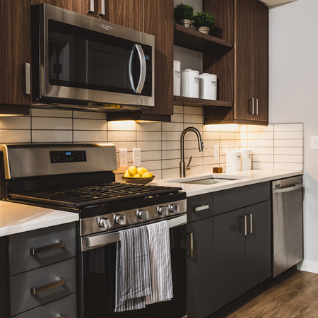 Kitchens with stainless steel appliances and custom cabinetry with chrome pulls