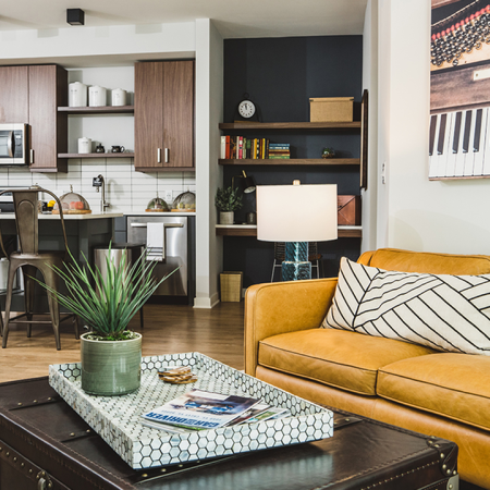 Gorgeous apartment homes with two-toned cabinetry, stainless steel appliances, and built-in work from home desk