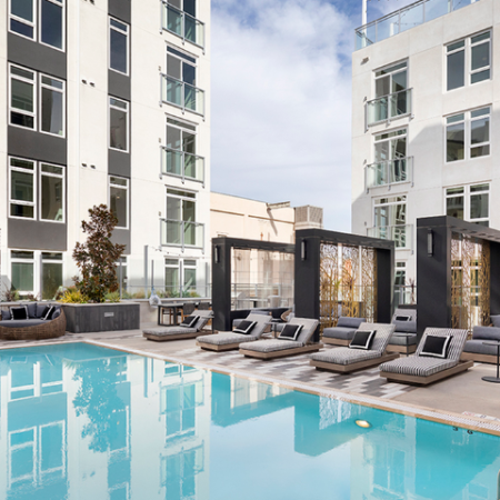 Swimming pool with sundeck, chaise lounges and exquisite outdoor couches
