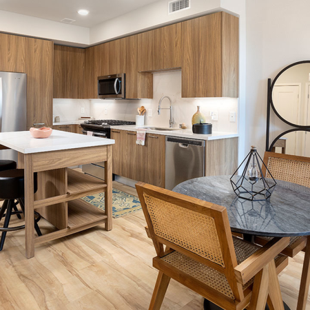Gourmet kitchens with chefs-island with storage, stainless steel appliances and gas cooking