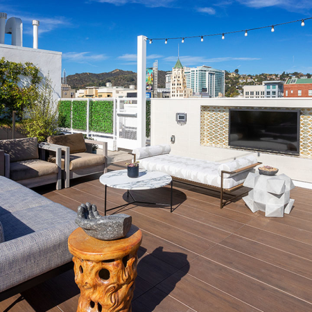 Rooftop sundeck with outdoor TV and lounge areas