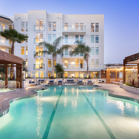 Swimming pool with lounges and cabana seating