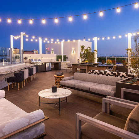 Gorgeous outdoor lounge area with grilling stations and alfresco dining