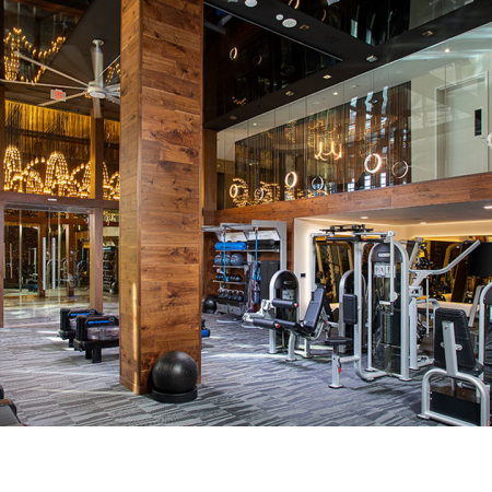 Expansive HIIT-inspired fitness center with cardio and weight stations
