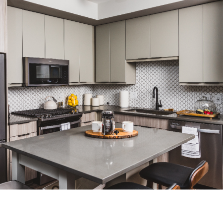 Kitchen featuring stainless-steel appliances and stone countertops with 42-inch custom cabinetry