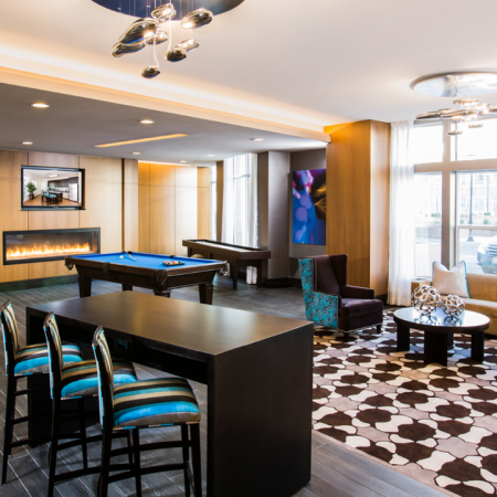 Resident lounge with billiards and shuffleboard tables and fireplace