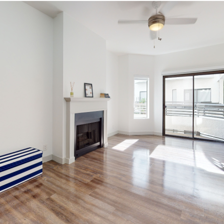 Open living room with wood-plank style flooring
