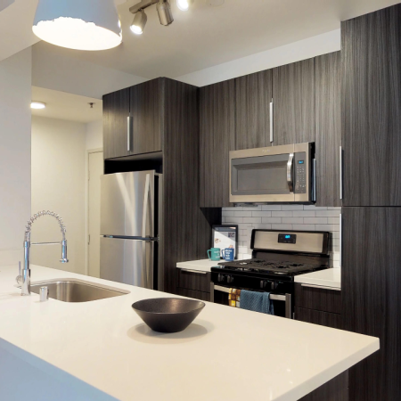 Modern kitchen with dark and light cabinetry