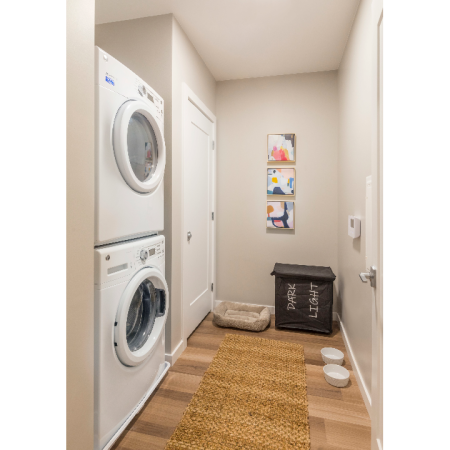 View of hallway featuring a Full-size front loading washers and dryers
