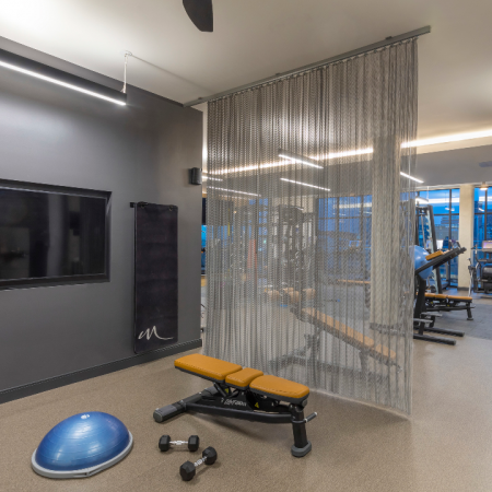 Club Quality Fitness Center with Large Flatscreen Displays, Weight Machines, and Cardio Equipment