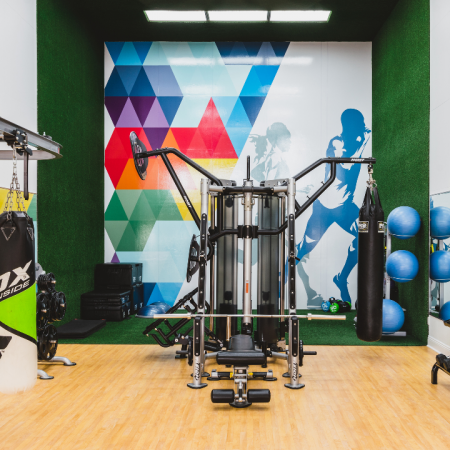 Fitness center with punching bags and free weights