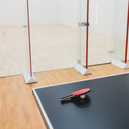Ping pong table against racquetball court