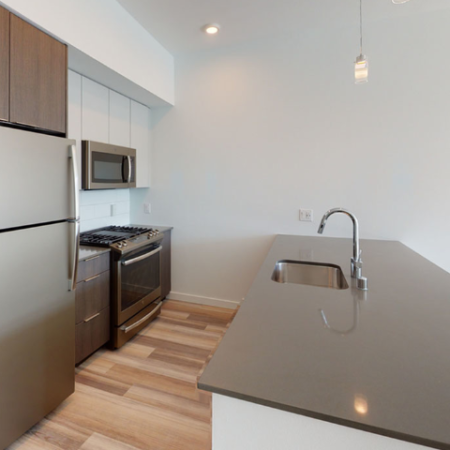 Open concept kitchens with large espresso cabinetry and stainless steel appliances