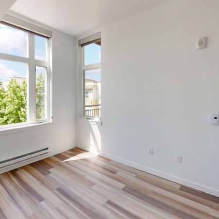 Bedrooms feature plank-style flooring and oversized windows