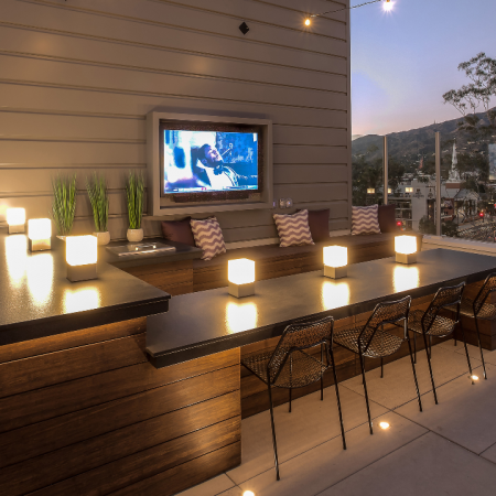 Rooftop resident lounge lit for the evening