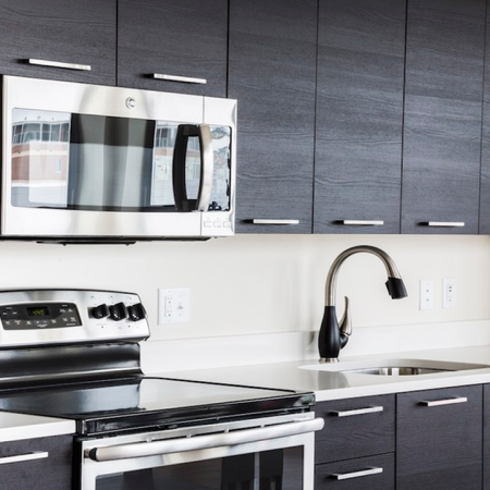 Kitchen with stainless steel appliances in an apartment at Modera Mosaic.