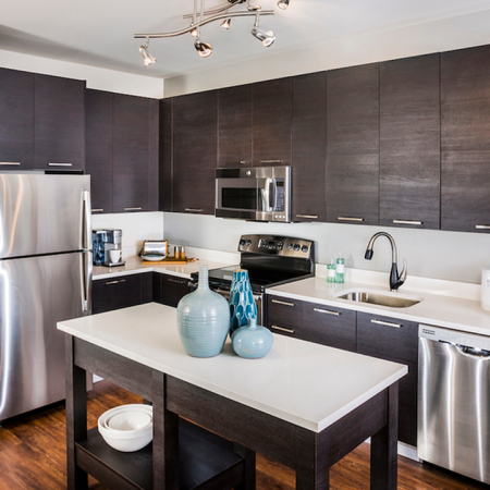 Kitchen with movable island in an apartment at Modera Mosaic in Fairfax, VA.