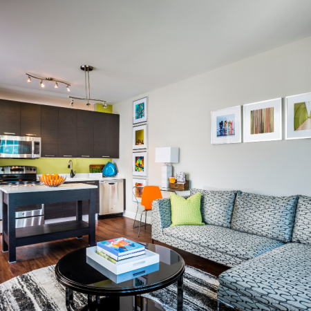 Furnished living room with wood plank style flooring in an apartment at Modera Mosaic.