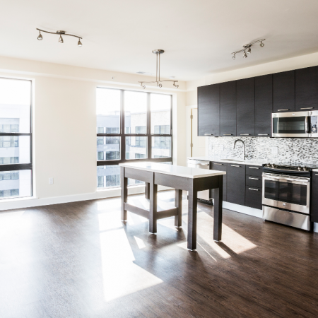 Open concept kitchen with stainless steel appliances in an apartment at Modera Mosaic.