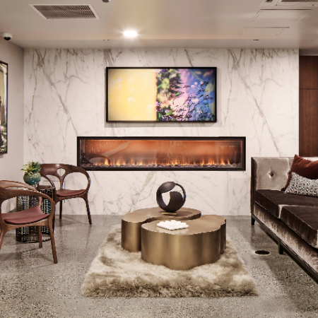 Lounge and lobby areas with plush seating and fire place at Modera Rincon Hill apartments.