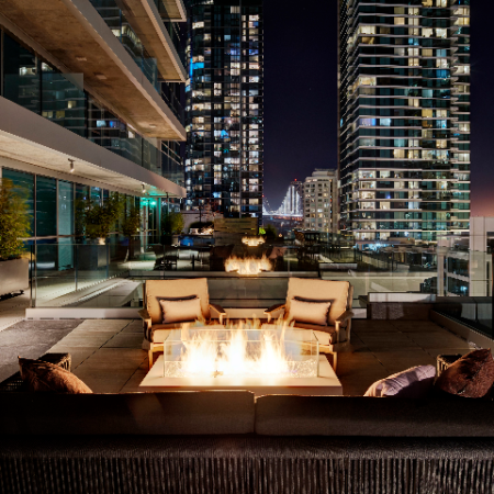 Enjoy a nighttime fire on our rooftop terrace at Modera Rincon Hill apartments.