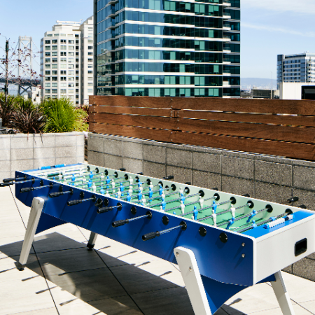 Get in the game with our rooftop foosball table at Modera Rincon Hill apartments.