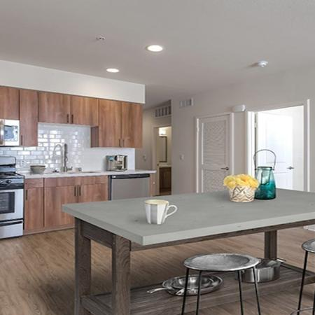 Open concept kitchen with stainless steel appliances