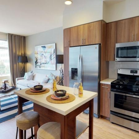 Brightly lit open concept kitchen and living space