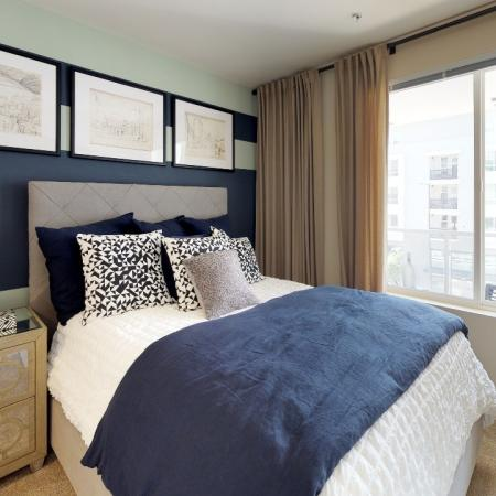 Furnished bedroom with wall to wall carpeting