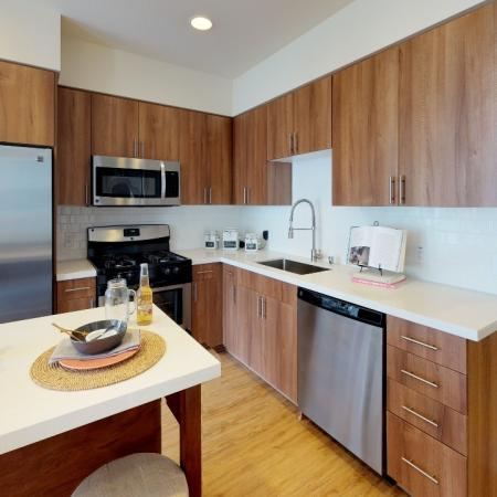 """L shaped kitchen with 42"""" cabinetry"""