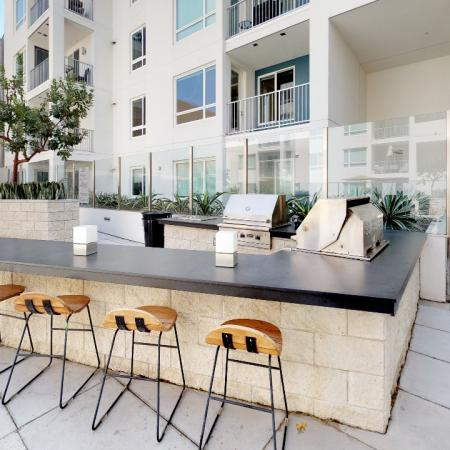 Outdoor grilling area with seated bar