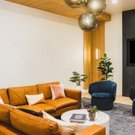 HDTV beside plush couches and HDTV at Modera Broadway apartments.
