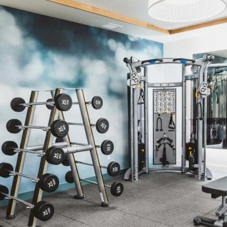 Free weights, weight bench, weight stations and spin bikes in the fitness studio at Modera Broadway apartments.