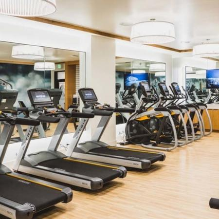 Cardio equipment includes treadmills, ellipticals and stair climbers at Modera Broadway apartments.