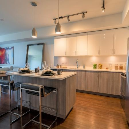 Residents Snacking in the Kitchen | Apartment Homes In Boca Raton | Allure Boca Raton