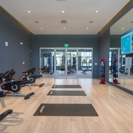 Residents Working Out at Fitness Center | Boca Raton Florida Apartments | Allure Boca Raton