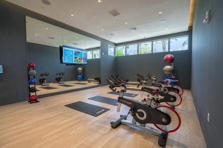 Residents Exercising at Fitness Center | Apartment Homes In Boca Raton | Allure Boca Raton