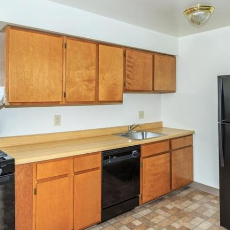 Residents Cooking in the Kitchen | Pet Friendly Apartments In Bethlehem PA | River Pointe