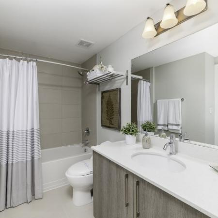 Bathroom with white and brown vanity.