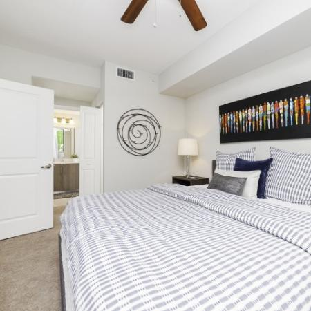 Bedroom with large king bed and plaid bedding.