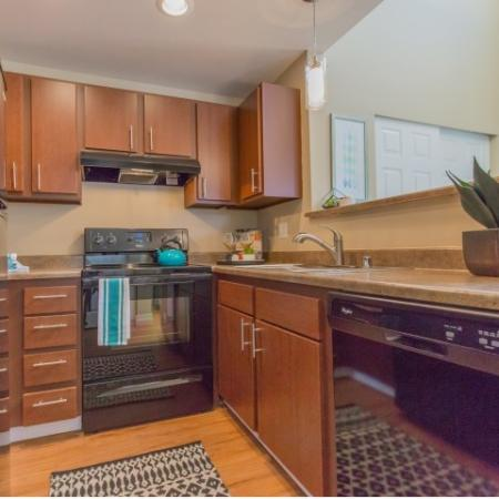 Kitchen with brown cabinets and counters.