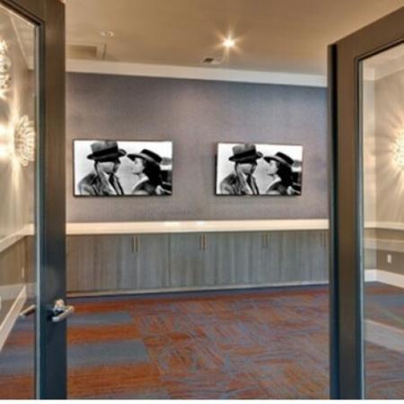 Two open glass doors facing vintage art.