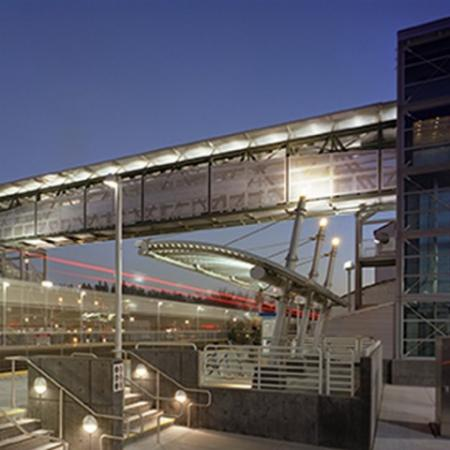 Night photo of light rail station.