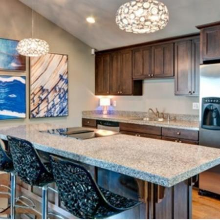 Clubhouse demonstration kitchen with 4 black barstools.