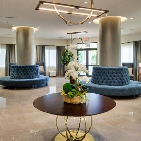 Lobby with round blue velvet seating.
