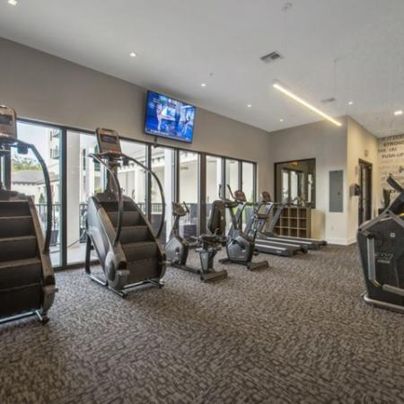 Fitness center with stair climbing machines.
